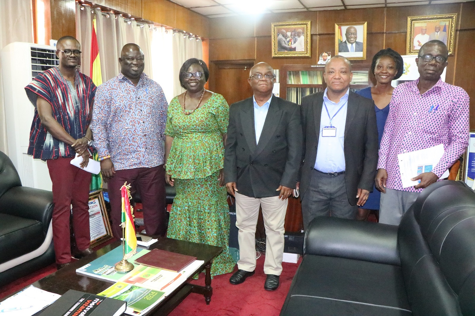 Nana Bakateyi, CEO of GLOWA and some staff of GLOWA pose with the Volta Regional Minister at his Office